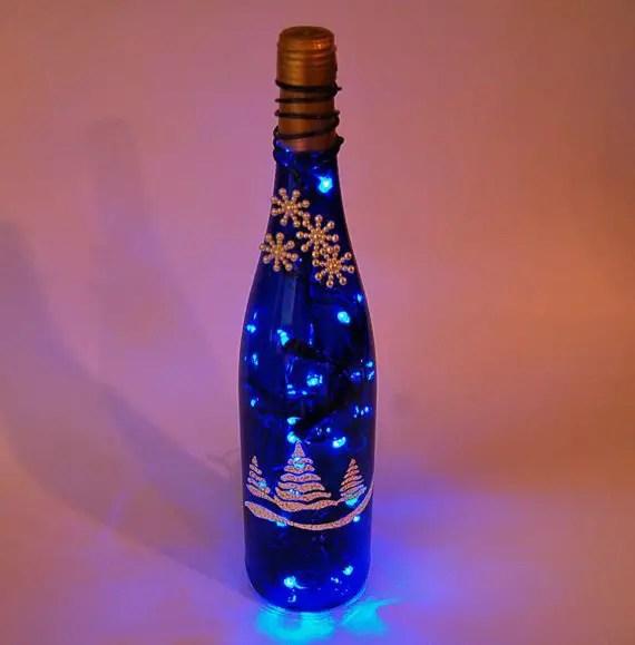 L mparas navide as con botellas de vino recicladas dale - Botellas con luces ...