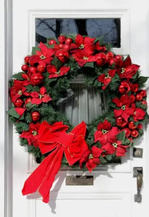 Front door with large wreath