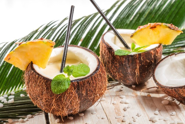 Pinacolada in a coconut on old white table