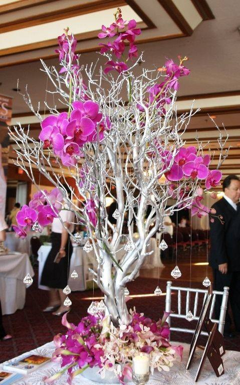 Hermosos centros de mesa con ramas secas