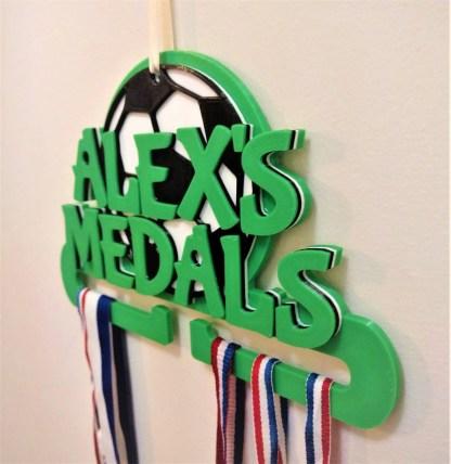 Football themed medal holder in green