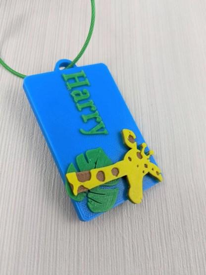 Giraffe themed luggage tag in blue