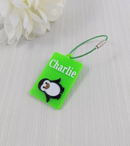 Penguin themed luggage tag in bright green