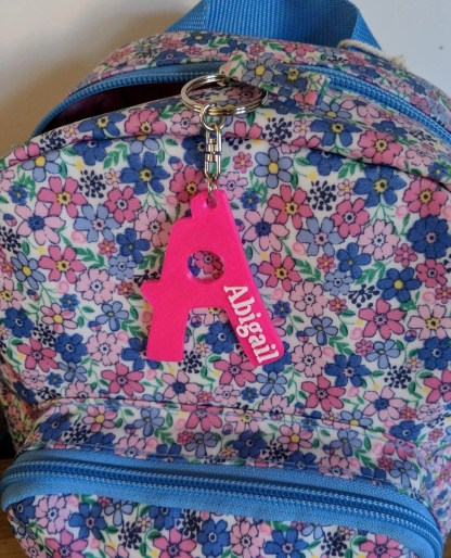 Keyring with name and initial letter in bright pink