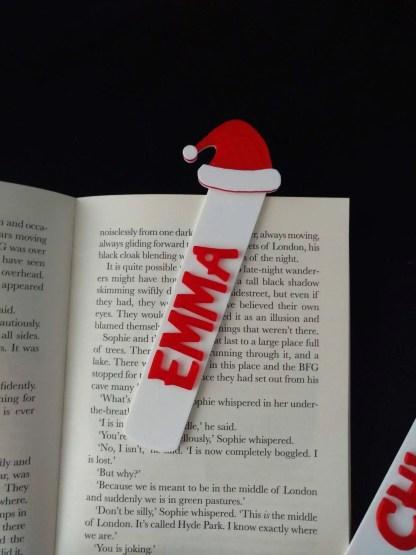 Santa hat themed bookmark in white