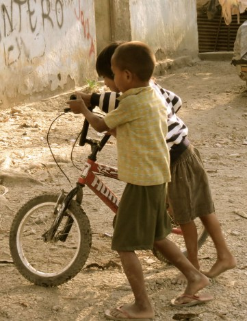 Boys play with a bicycle in Dili, Timor-Leste's capital.