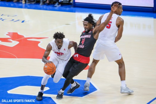 SMU guard Emmanuel Bandoumel dribbles around Jacksonville State guard Ty Hudson during the game between SMU and Jacksonville State on November 5, 2019 at Moody Coliseum in Dallas, Tx. (Photo by Joseph Barringhaus/Dallas Sports Fanatics)
