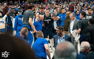 Dwight Powell is helped off the court after suffering a season-ending Achilles injury as theDallas Mavericks take on the Los Angeles Clippers, on January 21, 2020, at American Airlines Center in Dallas, Tx. (Photos by Michael Lark/Dallas Sports Fanatic)