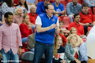An SMU fan cheers from the sideline during the American Athletic Conference college basketball game between the SMU Mustangs and the Wichita State Shockers on March 1, 2020 at Moody Coliseum in Dallas, Texas. (Photo by Joseph Barringhaus/Dallas Sports Fanatic)
