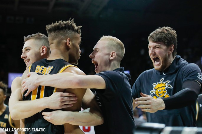 The Wichita State bench celebrates with guard Dexter Dennis (0) during the American Athletic Conference college basketball game between the SMU Mustangs and the Wichita State Shockers on March 1, 2020 at Moody Coliseum in Dallas, Texas. (Photo by Joseph Barringhaus/Dallas Sports Fanatic)