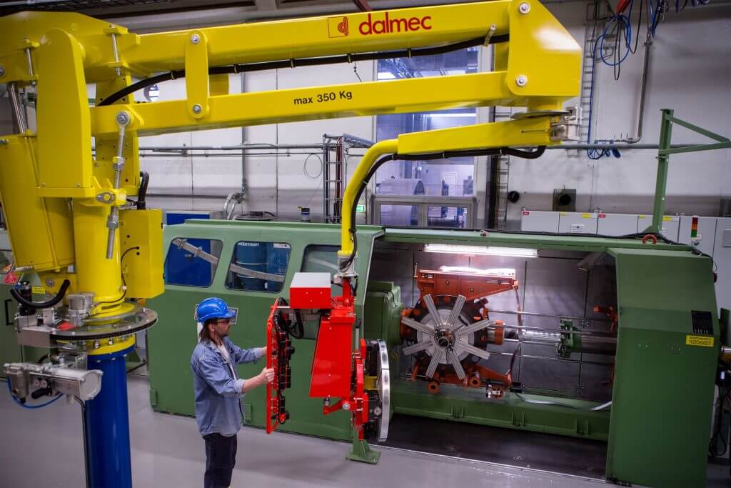 Lift assist device for rolls of metallic banding