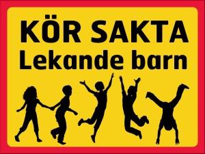 Skylt, kör sakta, lekande barn, gul/röd/svart