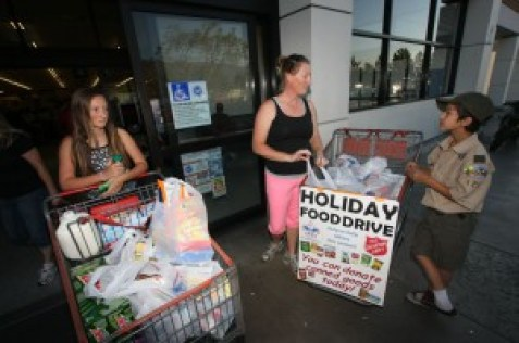 Christine and Cayleigh: Christine Stutson (Center), from San Bernardino and her daughter Cayleigh Brown 13 (left), were among those who help fill the basket assigned to Scout William Anderson 11(right), who attends Little Mountain Elementary School.