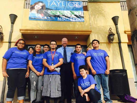 Tim Smith Taylion Academy president, stands with students from the school.
