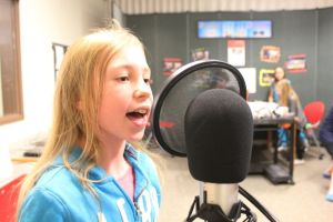 Ella Morrison didn't seem shy as she belted out the lyrics to her favourite songs during a tour of the Spruce Grove Library's Innovation Lab on Jan. 16. Morrison was using the library's GarageBand technology to record her voice. - Karen Haynes, Reporter/Examiner