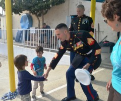 Sgt. John Kladitis with the Camp Pendleton-based 2nd Battalion 4th Marines thanks preschooler Kai Cena from Dana Point Montessori for donating food to military families. Courtesy photo