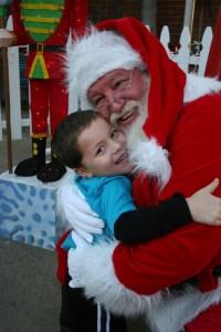 Santa Claus gets a big hug from Gavin Petin, 4, at the Dana Point Harbor last year. Photo by Andrea Swayne