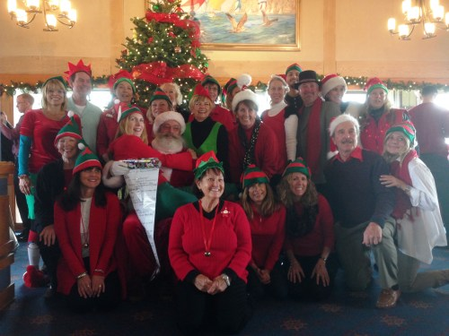 Volunteer elves from the Dana Point Yacht Club pose for a picture with Santa Claus. The group hosted about 50 Marine families from Camp Pendleton Saturday, December 7 for dinner and a gift giveaway. Courtesy photo