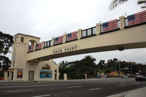 The pedestrian bridge marking the gateway into the now 25-year-old city of Dana Point is seen here decorated for last year's July 4 celebration. Photo by Andrea Swayne