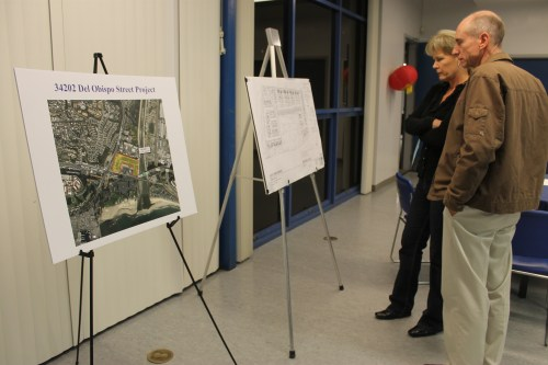 Residents review blue print plans that layout a proposed mixed-use development, with 169 units, at Pacific Coast Highway and Del Obispo Street. The project is still in the early planning phases, and public input is currently being accepted. Photo by Andrea Papagianis