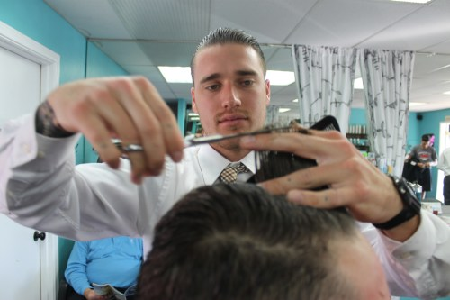 Matthew Schnitzer trims a client's hair. Photo by Andrea Papagianis
