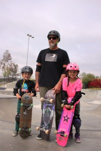 Longtime Dana Point resident Jason Kenworthy and his children, 7-year-old Bella and 5-year-old Loyal, travel throughout Orange and San Diego counties for safe places to skateboard. Photo by Steve Breazeale