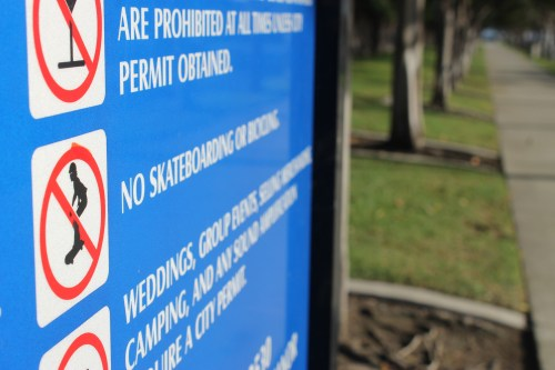 Signs are posted at all 23 Dana Point city parks informing visitors of rules that include no skateboarding. A recent movement has revived the debate about building a skatepark in Dana Point. Photo by Andrea Papagianis