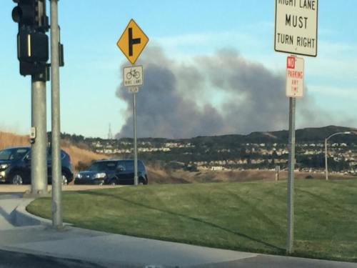 Smoke was seen rising up from behind San Clemente shortly before dusk, due to a brush fire on Camp Pendleton. Photo: Wendy Peloso