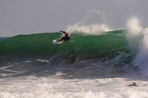 David Economos finishes out the wave pictured above. Photo: Jack McDaniel