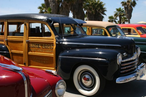 Doheny Wood brings more than 100 classic woodie wagons to the beach for a day of food, fun, shiny candy-colored paint jobs and glistening chrome. Photo: Andrea Swayne