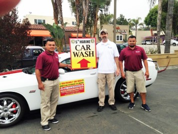 Doheny Village Hand Car Wash owner James Surber, center, is hosting the Dana Point 5th Marine Regiment Support Group Eco-friendly Car Wash on Saturday. Photo: Courtesy