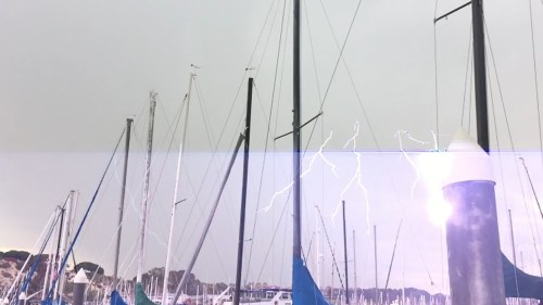 This is a screen shot submitted by Dana Point Times reader Kendra Stroh from a video she took of a lightning strike Tuesday at the Dana Point Harbor.