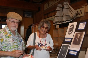 Neal and Monica Singer enjoy birthday cake in the Ocean Institute boat barn while perusing historical photos and artifacts representing the life of R.H. Dana. Photo: Andrea Swayne