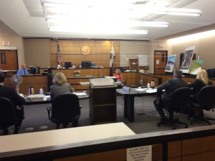 Attorneys (L to R) Blaine P. Kerr, deputy attorney general and Jamee Jordan Patterson, supervising attorney general representing the California Coastal Commission, along with A. Patrick Munoz and Jennifer Farrell, representing the city of Dana Point, prepare for the arrival of San Diego Superior Court Judge Randa Trapp on Aug. 24, the start of a bench trial to decide whether the city's nuisance abatement ordinance was pretext for avoiding requirements of the Local Coastal Program in order to keep gates and limited hours at the two of five pathways to Strand Beach passing through a residential neighborhood. Photo: Andrea Swayne