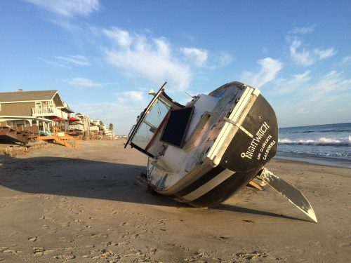 A boat that ran aground at Capistrano Beach on Aug. 21 leaves residents questioning when and by whom will it be removed. Photo: Andrea Swayne