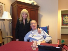Mitch Higginbotham gets a visit at his Rancho Mirage nursing home from longtime Dana Point friend Willa Porter. Photo: Pete Hammer