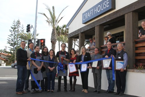 Craft House owner Blake Mellgren (at center holding the scissors) celebrated the grand opening of his new Lantern District restaurant with his staff, city and chamber of commerce officials on March 9 with an official ribbon cutting. Photo: Andrea Swayne
