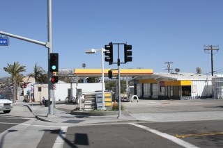 The Shell Station at PCH and Amber Lantern is among the structures now fenced off and slated for demolition to make way for the Majestic/Raintree project. Photo: Andrea Swayne