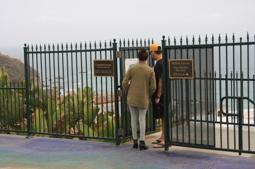 For now, gates at the two of five access ways from Strand Vista Park to Dana Strand Beach are locked open 24/7. After consideration by the Coastal Commission on April 15, an agreement between city staff and Coastal Commission staff could change closed hours to 10 p.m. to 5 a.m. Two other paths will remain open 24/7. Photo: Andrea Swayne
