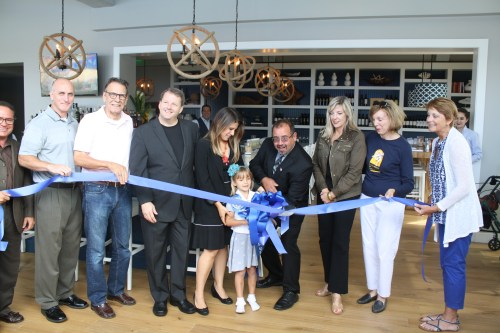 City officials and Coastal Kitchen Owners Christina and Mike Grant, held a ribbon cutting ceremony to officially open Coastal Kitchen on Monday. Photo: Kristina Pritchett