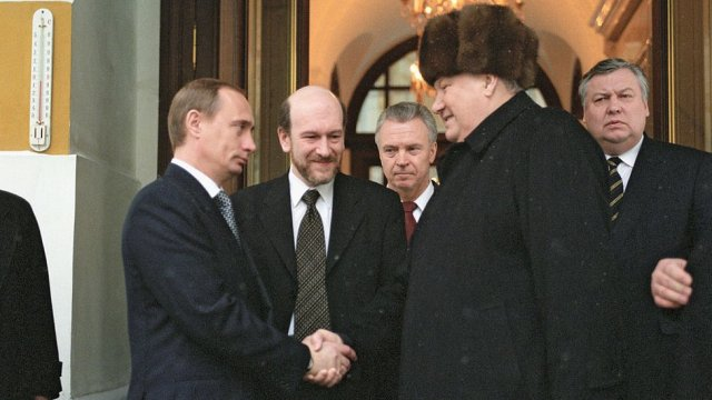 Putin shaking hands with Boris Yeltsin