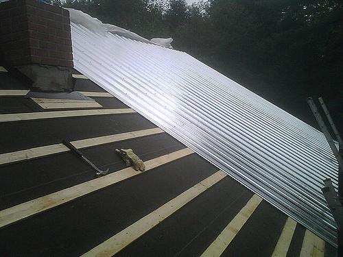 Metal roof being installed