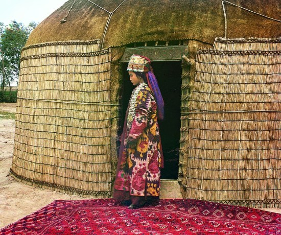 woman in front of a yurt