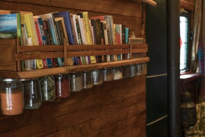 Simple solid oak bookshelf and herb stores