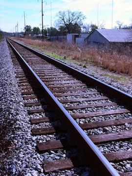 Image: Railroad tracks going off into the distance.