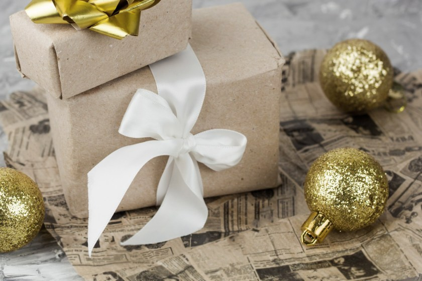 What is the best way to give a business gift to employees or a client during the holiday season?