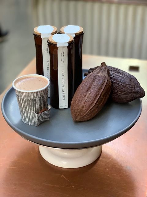 Dandelion Chocolate hot chocolate and cacao pods