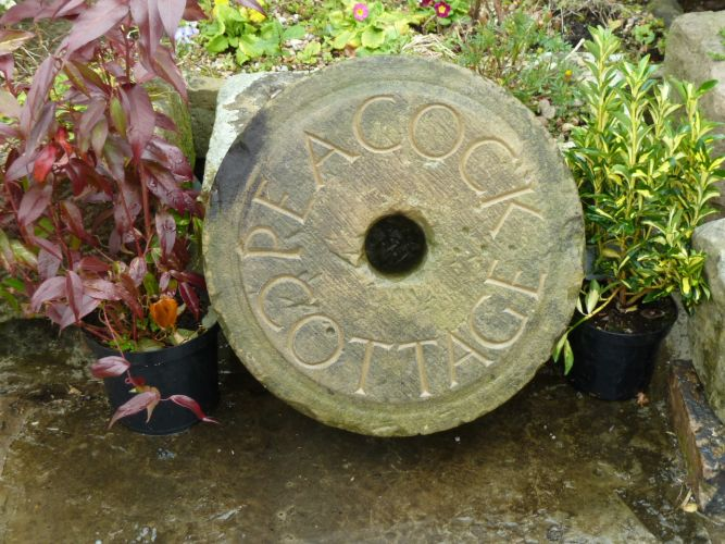 Carved Peacock Cottage Millstone