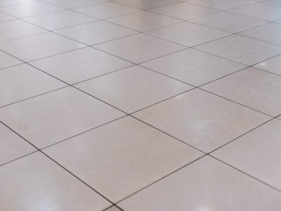Beige tile on the floor in perspective
