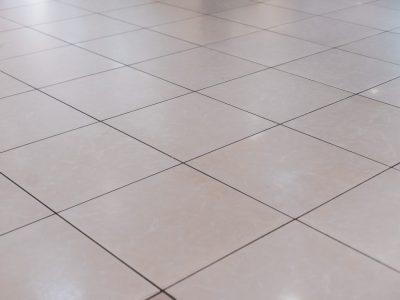Beige tile on the floor in perspective